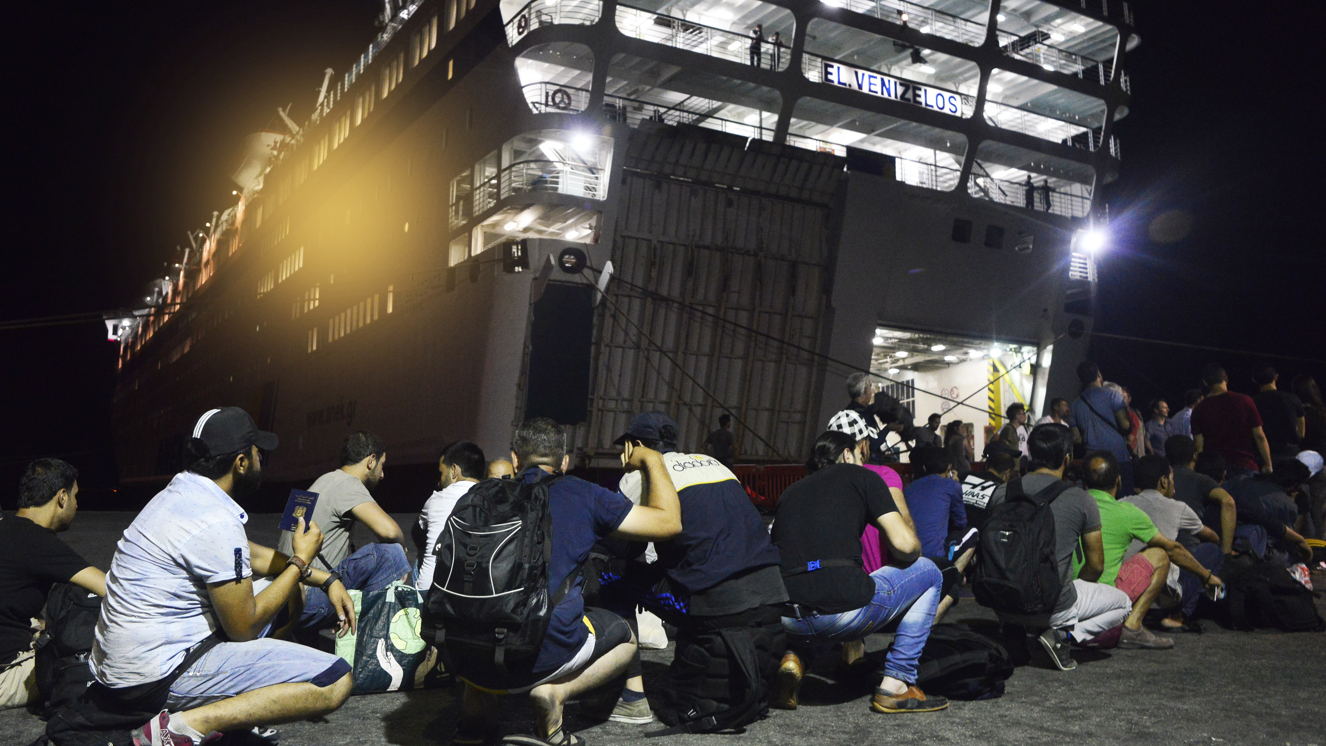 Syrian refugees prepare to board the passenger ship Eleftherios Venizelos at Kos's main port on Sunday in Kos, Greece. The vessel will house more than 2,500 refugees and migrants who entered the country from the Turkish coast. Milos Bicanski/Getty Images