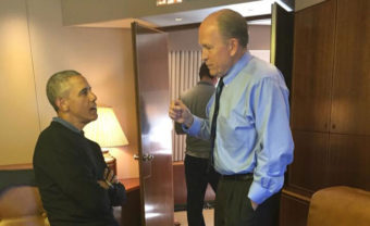 Gov. Bill Walker talks with President Barack Obama on Air Force one. The president is visiting Alaska to observe the effects of climate change. (Photo courtesy of Gov. Bill Walker's office)