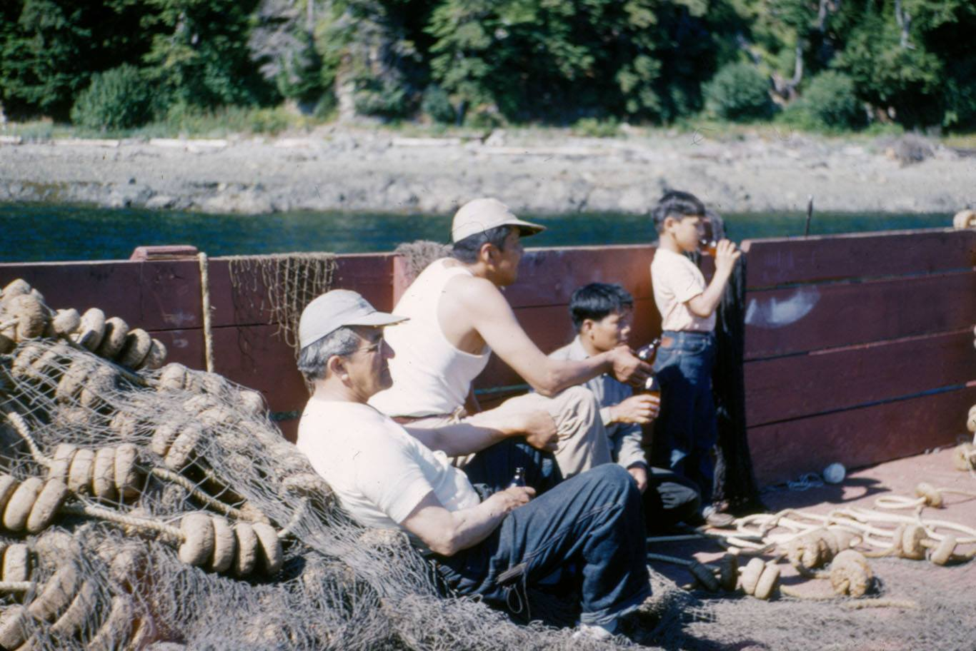 William L. Paul Sr. (left) with Walter Soboleff, M. Quinto and Ray Peck on a boat. (Photo courtesy of Sealaska Heritage)