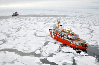 The Canadian Coast Guard Ship Louis S. St-Laurent makes an approach to the Coast Guard Cutter Healy in the Arctic Ocean. (Photo by Patrick Kelley/U.S. Coast Guard)