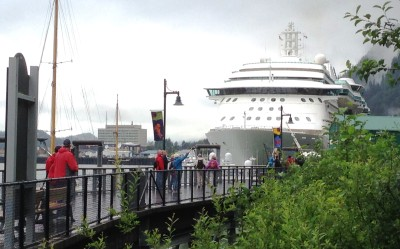 Tourists walk toward the cruise ship Radiance of the Seas, docked at Juneau's waterfront. (Photo by Ed Schoenfeld,/CoastAlaska News)