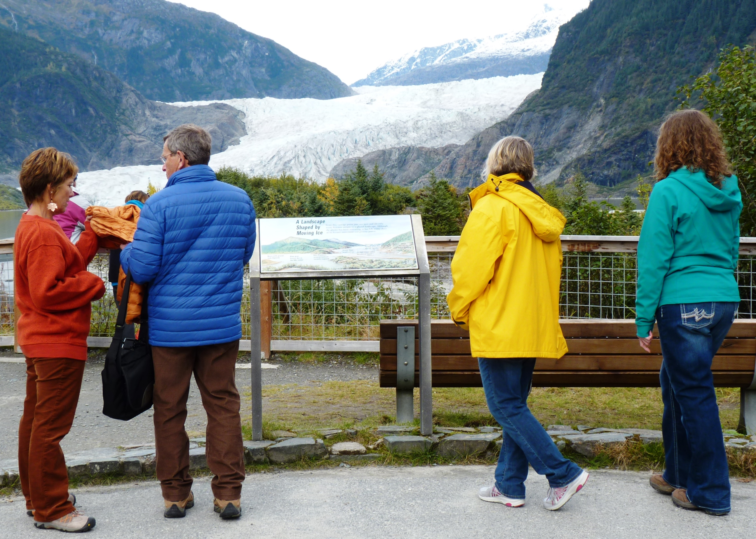 9-22-15 Tourists check out the A Landscape Shaped By Moving Ice sign at the Mendenhall Glacier