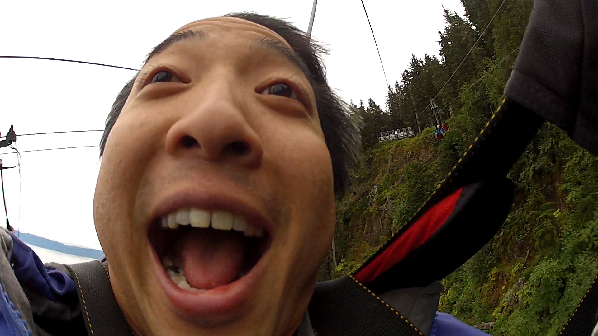 A GoPro selfie while riding the Icy Strait Point ZipRider. (Video still by Jeremy Hsieh/KTOO)