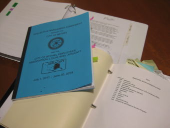 "The City's Municipal Code, Union Agreement, and Employee Handbook, which the City Administrator and City Attorney are creating drafts of to include ""sexual orientation"" and ""gender identity"" under protected classes. (Photo by Anna Rose MacArthur/KYUK)"