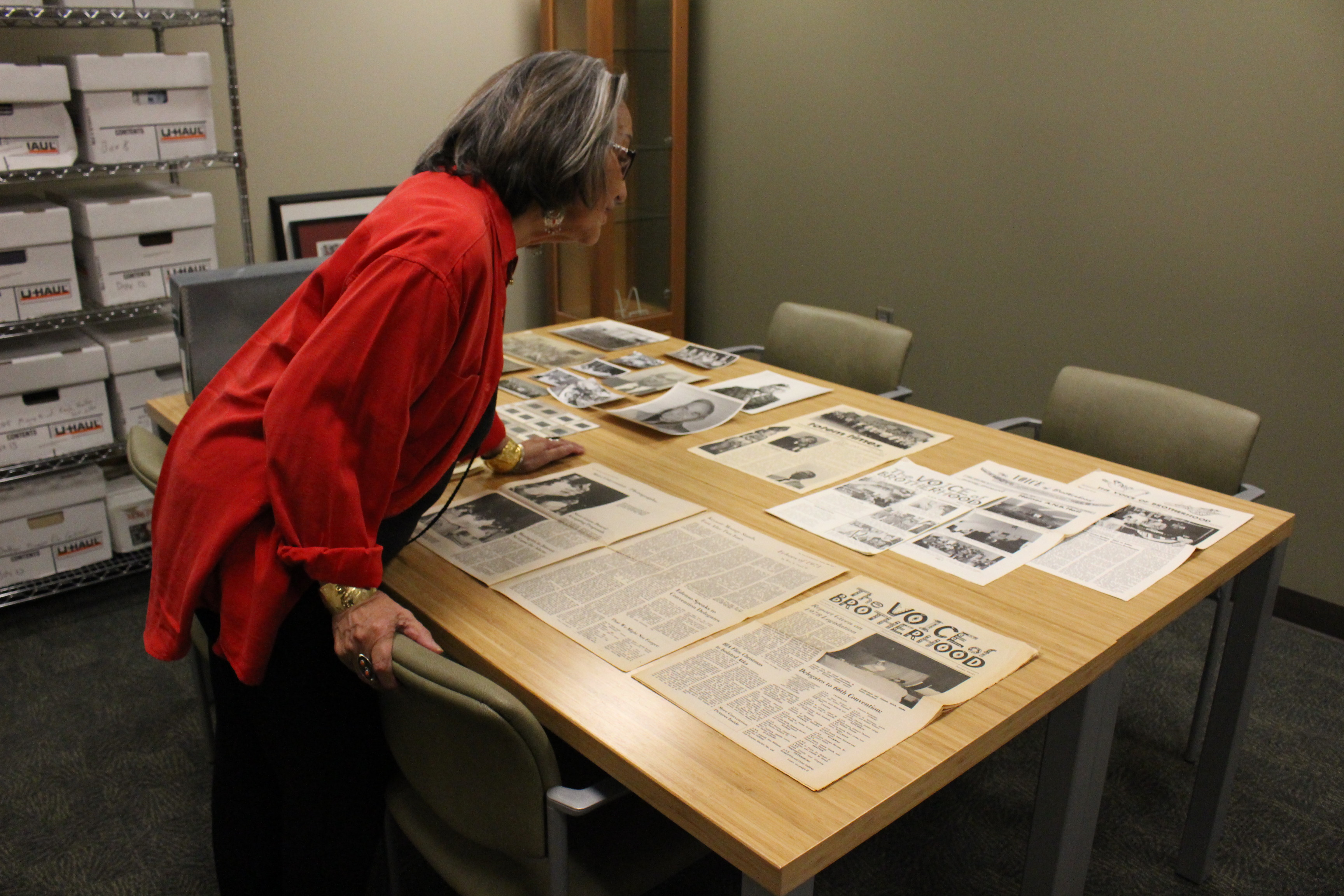 Rosita Worl marvels over the donated collection in the William Paul Archives. (Photo by Elizabeth Jenkins/KTOO)