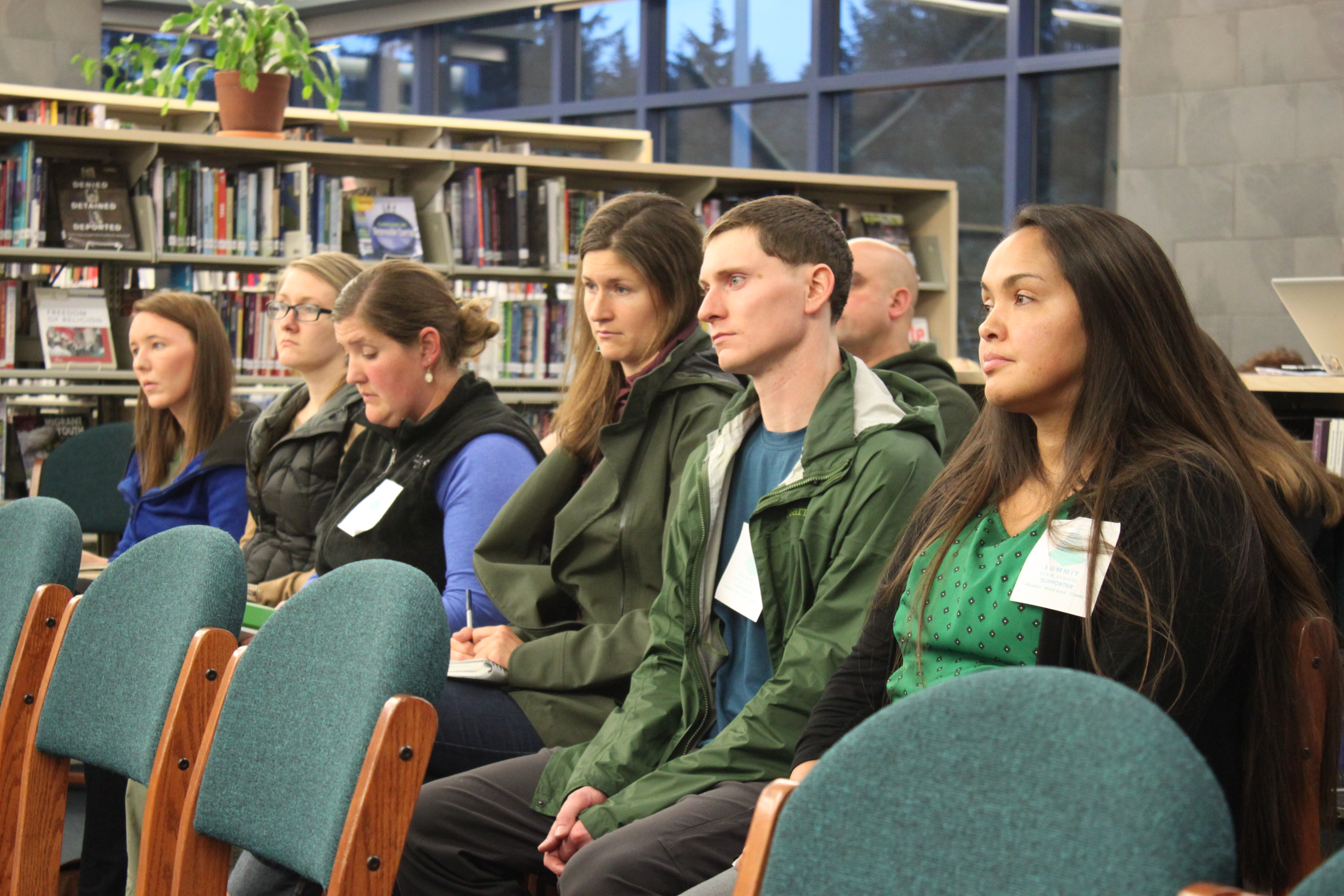 Summit STEM School supporters and organizers sit in the audience of Tuesday's regular School Board meeting. (Photo by Lisa Phu/KTOO)