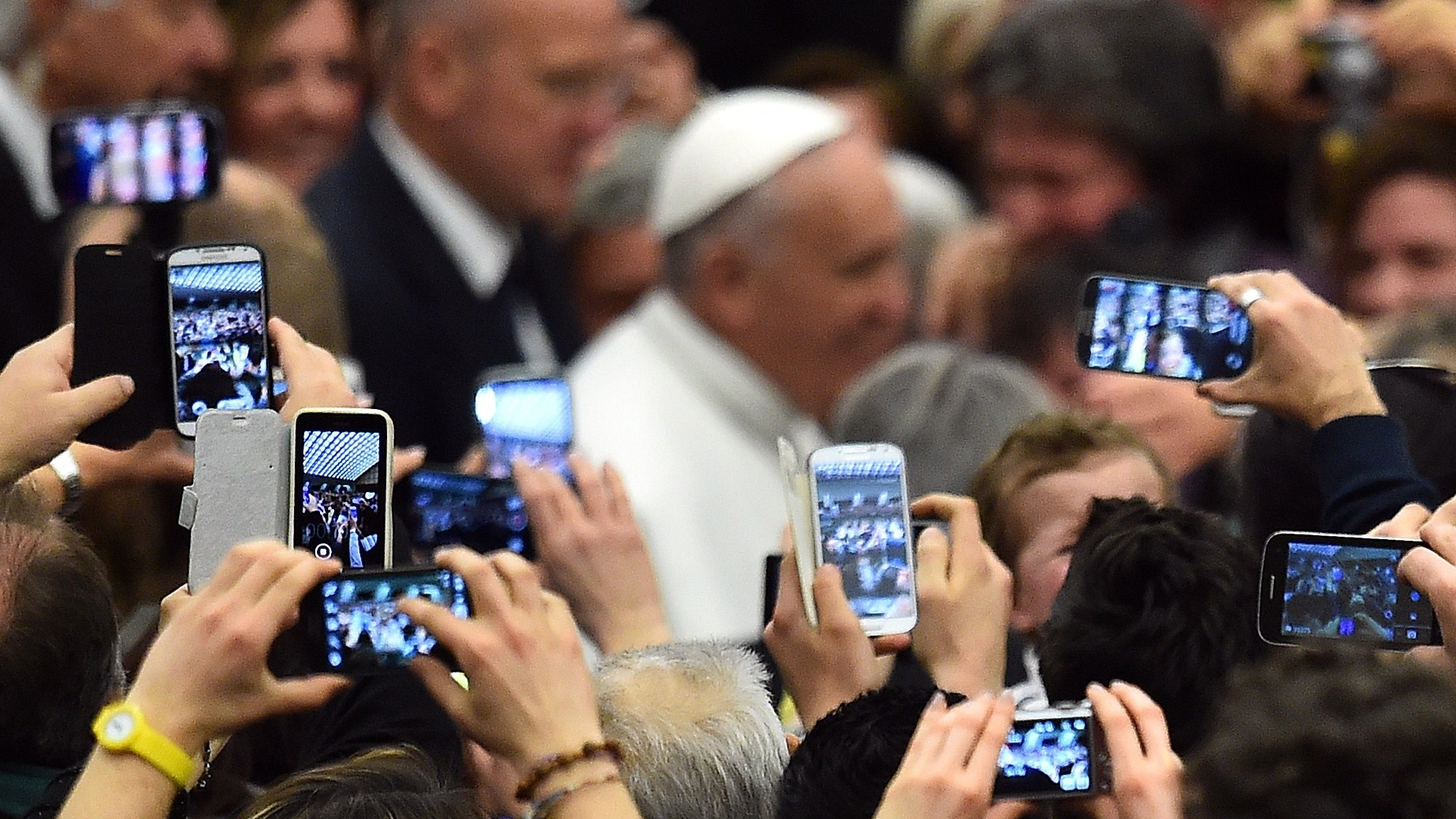 "Pope Francis' embracing of the digital world and social media has given new meaning to the word ""followers"" for the Catholic Church.  Gabriel Bouys/AFP/Getty Images"