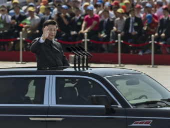 Xi Jinping presided over a Beijing military parade marking the 70th anniversary of the end of World War II. To some observers, this showed Xi in firm political and military control. On the economic side, though, the signals are more mixed. Kevin Frayer/Getty Images
