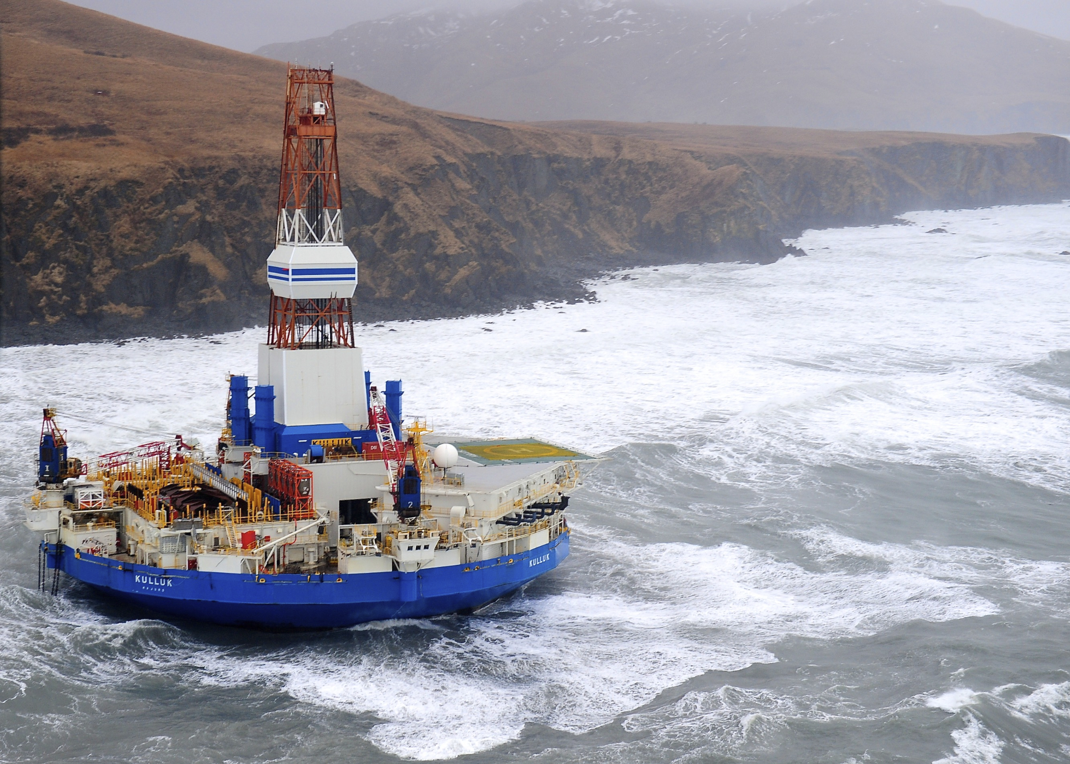 The Kulluk is an Arctic drill rig owned by Royal Dutch Shell. In 2012, the rig ran aground off Sitkalidak Island near Kodiak Island. The highly publicized incident was used by drilling opponents as an example of Shell's lack of qualifications to drill in the Arctic. (Photo by Petty Officer 1st Class Sara Francis/U.S. Coast Guard)