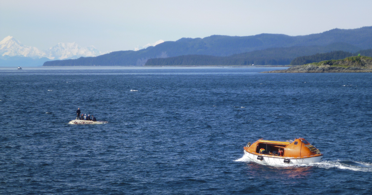 The LeConte state ferry launches a lifeboat to rescue six men from an overturned boat. (Photo courtesy Janet Neilson)