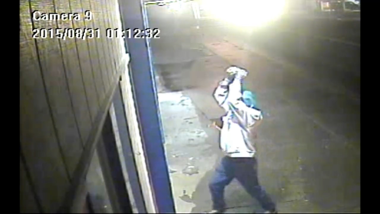 A video still of someone who smashed a window and stole cigarettes from Thibodeau's Home Liquor on Sept. 1, 2015.
