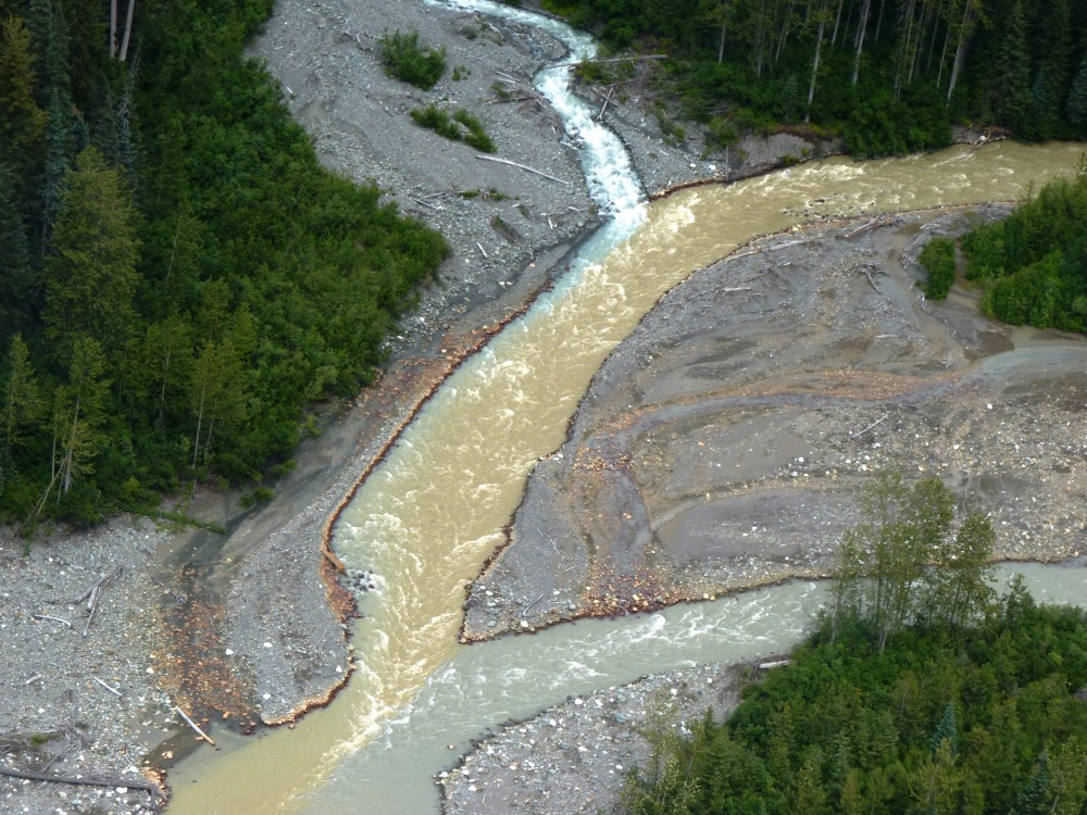 Sulphurets Creek, which drains naturally occurring rusty water from the KSM prospect, enters Mitchell Creek. (Photo by Ed Schoenfeld/CoastAlaska News)