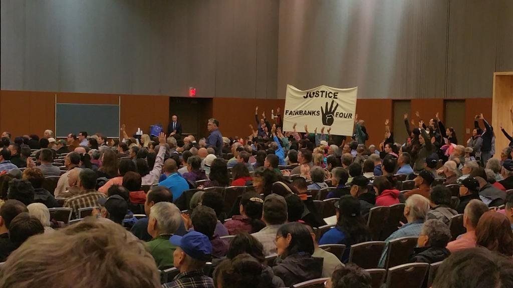 Protestors shouts out in support of the Fairbanks Four during Gov Bill Walker's address to the Alaska Federation of Natives convention. (Photo by Jennifer Canfield/KTOO)