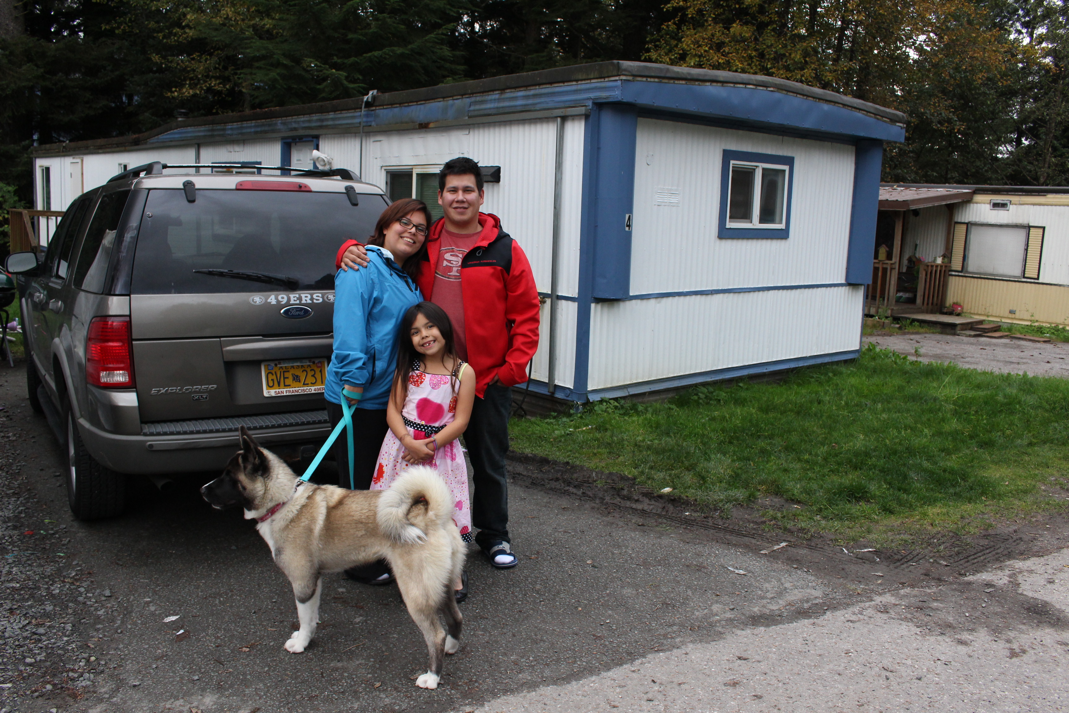 James Refeurzo and his family outside their family home. (Photo by Elizabeth Jenkins/KTOO)