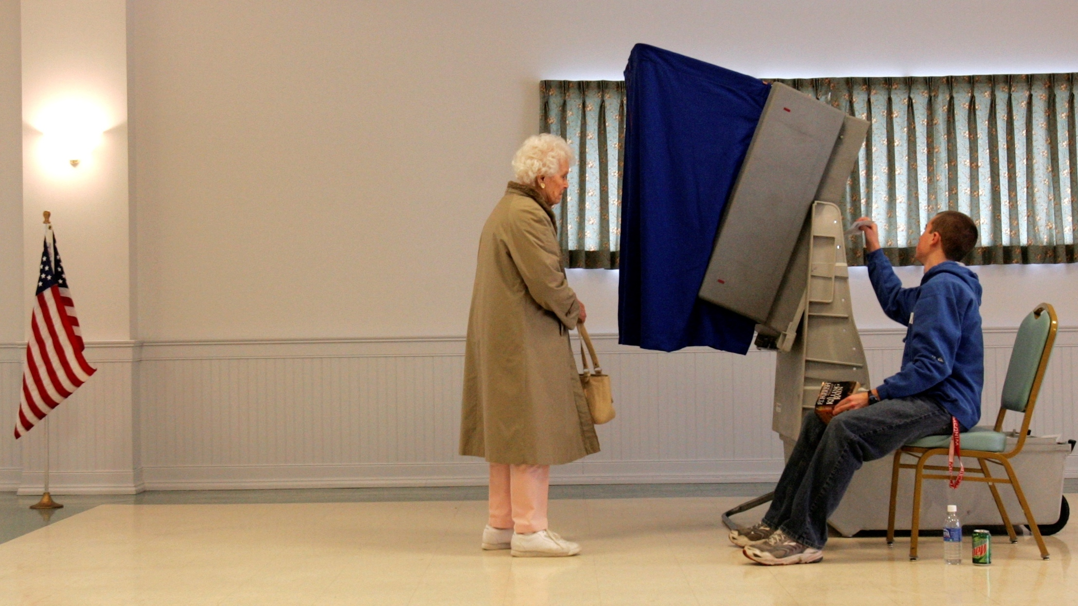 An election worker resets a voting machine as a voter waits in 2008. Many of the country's machines were replaced after the 2000 election, but are now reaching the end of their useful lives. (Photo by Rob Carr/AP)