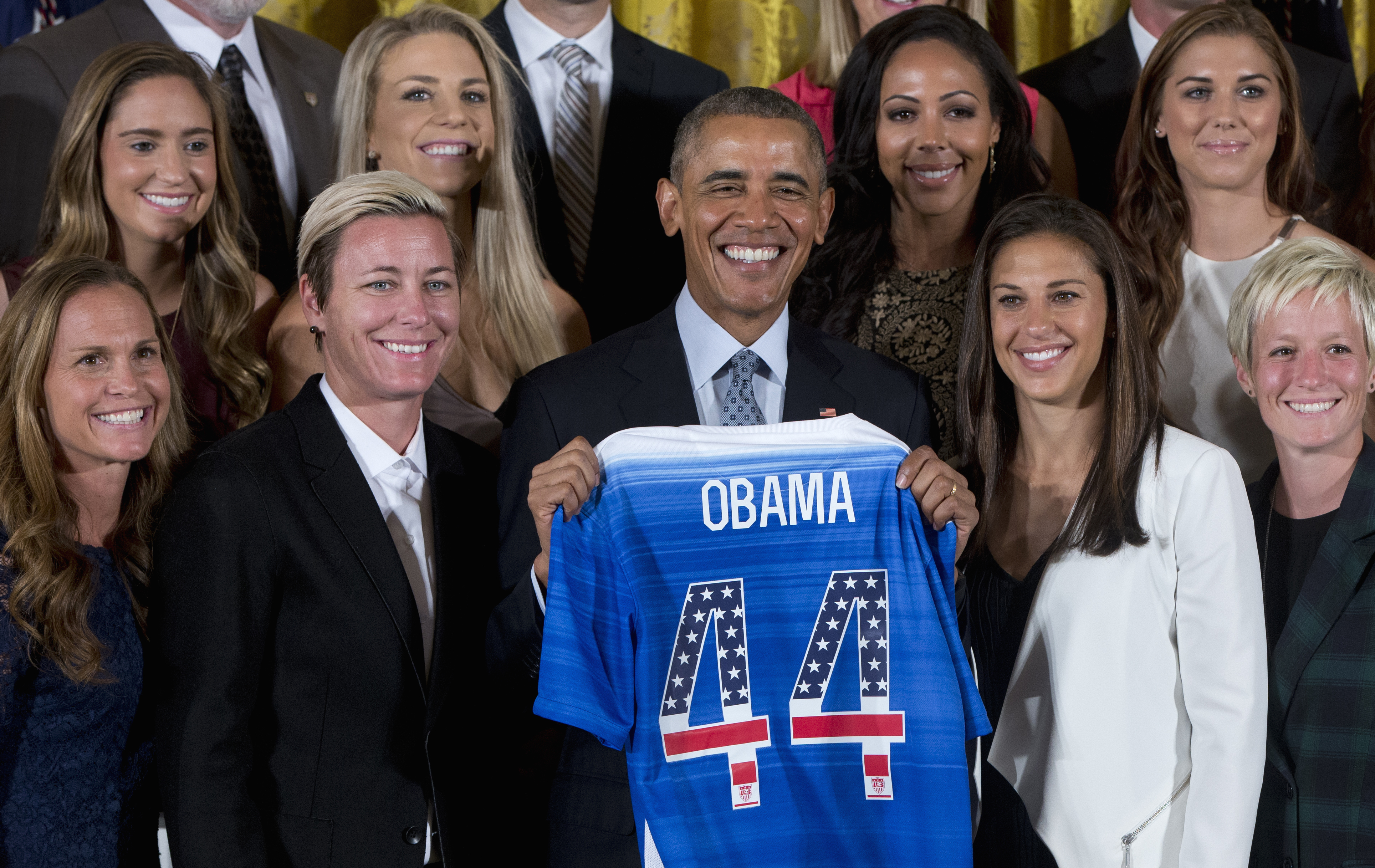 President Obama poses with a jersey he received from the U.S. Women's National Soccer Team during a ceremony to honor the team and their victory in the 2015 FIFA Women's World Cup. Standing with Obama are (from left) Christie Rampone, Morgan Brian, Abby Wambach, Julie Johnston, Sydney Leroux, Carli Lloyd, Alex Morgan, and Megan Rapinoe. Carolyn Kaster/AP