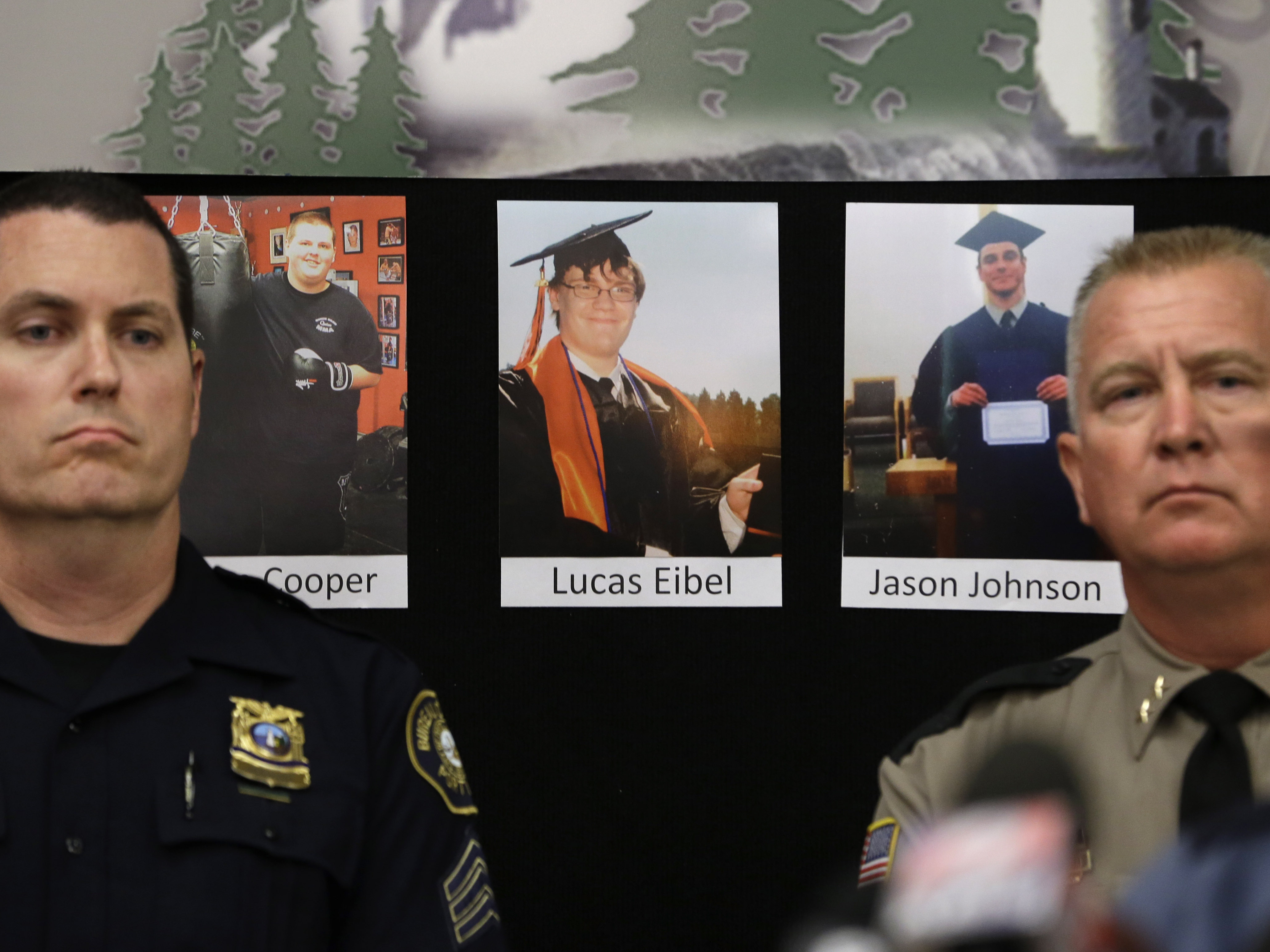 Photos of victims of the mass shooting at Umpqua Community College in Roseburg, Ore., are displayed behind Portland Police Sgt. Peter Simpson (left) and Douglas County Sheriff John Hanlin. (Photo by Rich Pedroncelli/AP)