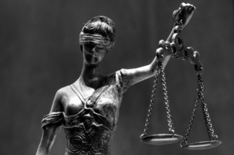 Blind Lady Justice with scales