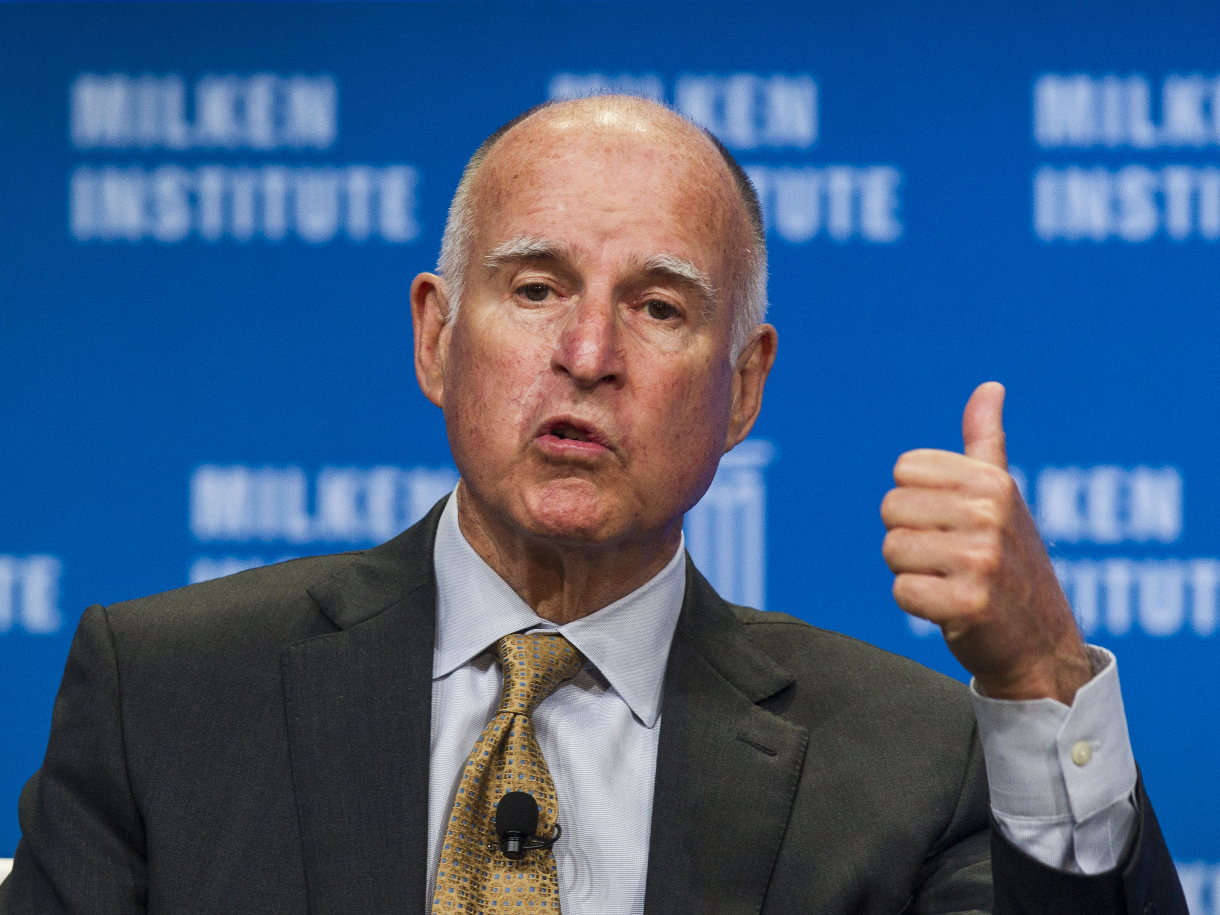 "California Gov. Jerry Brown signed into law the states so-called ""motor voter"" law in hopes of boosting turnout in future elections. The state had 42 percent turnout in the 2014 midterms, a record low. (Photo by Ringo H.W. Chiu/AP)"