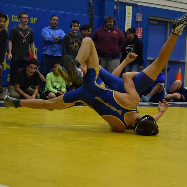 Bethel Warrior Thomas Dyment facing off against a wrestler from Nome at BRHS. (Photo Courtesy of Hugh Dyment)