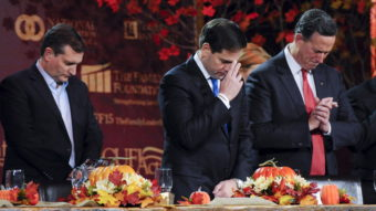 Republican U.S. presidential candidates Ted Cruz, Marco Rubio and Rick Santorum pray at the Presidential Family Forum in Des Moines, Iowa, November 20, 2015. The question of how to treat Syrian refugees has evoked different reactions in political evangelicals. Mark Kauzlarich/Reuters