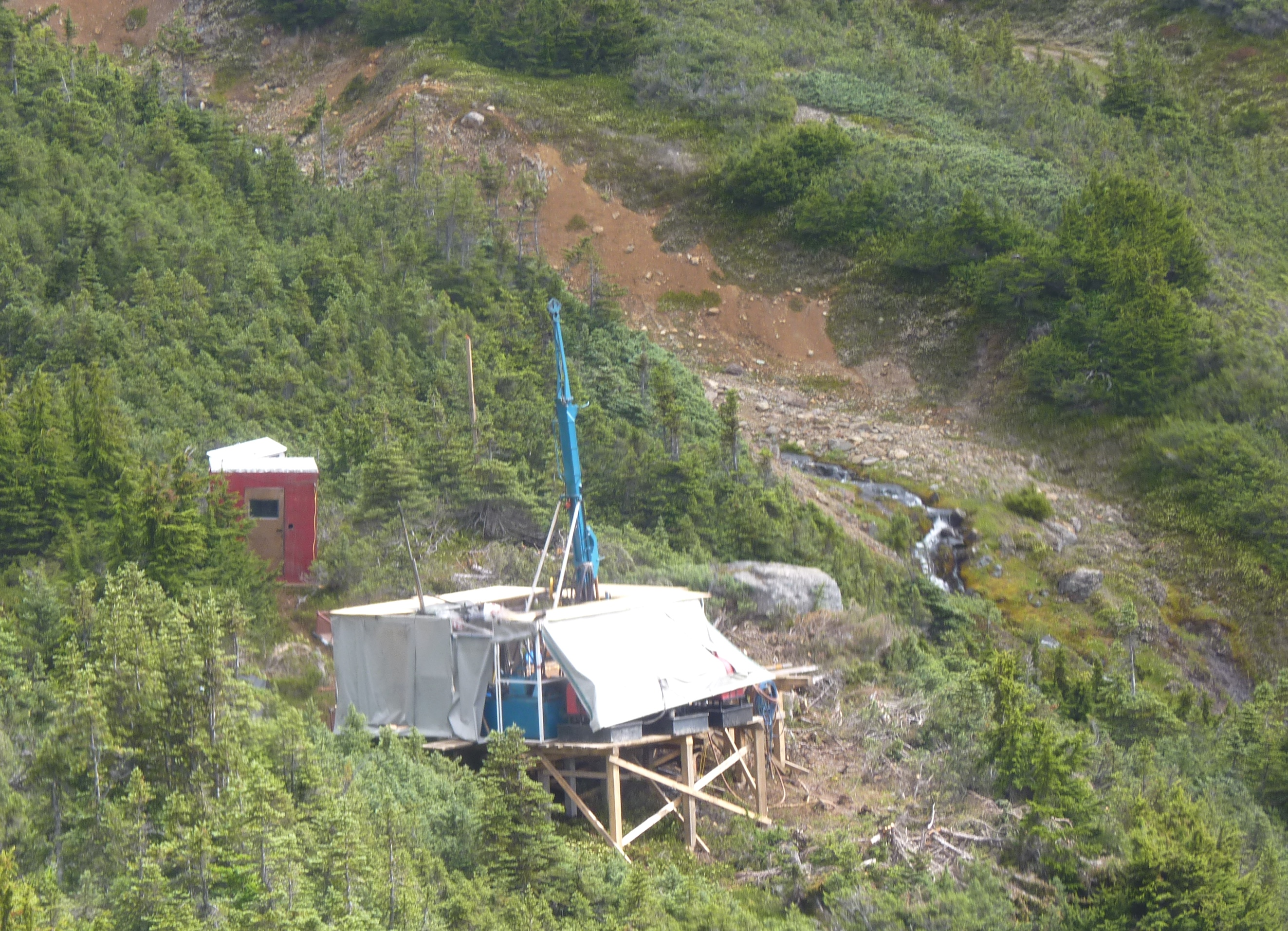 A drilling rig perches on the edge of a valley where Seabridge Gold's KSM mine project is under exploration. Summer drilling expanded the boundaries of a rich deposit that could be more profitable than earlier discoveries. (Photo by Ed Schoenfeld/CoastAlaska News)