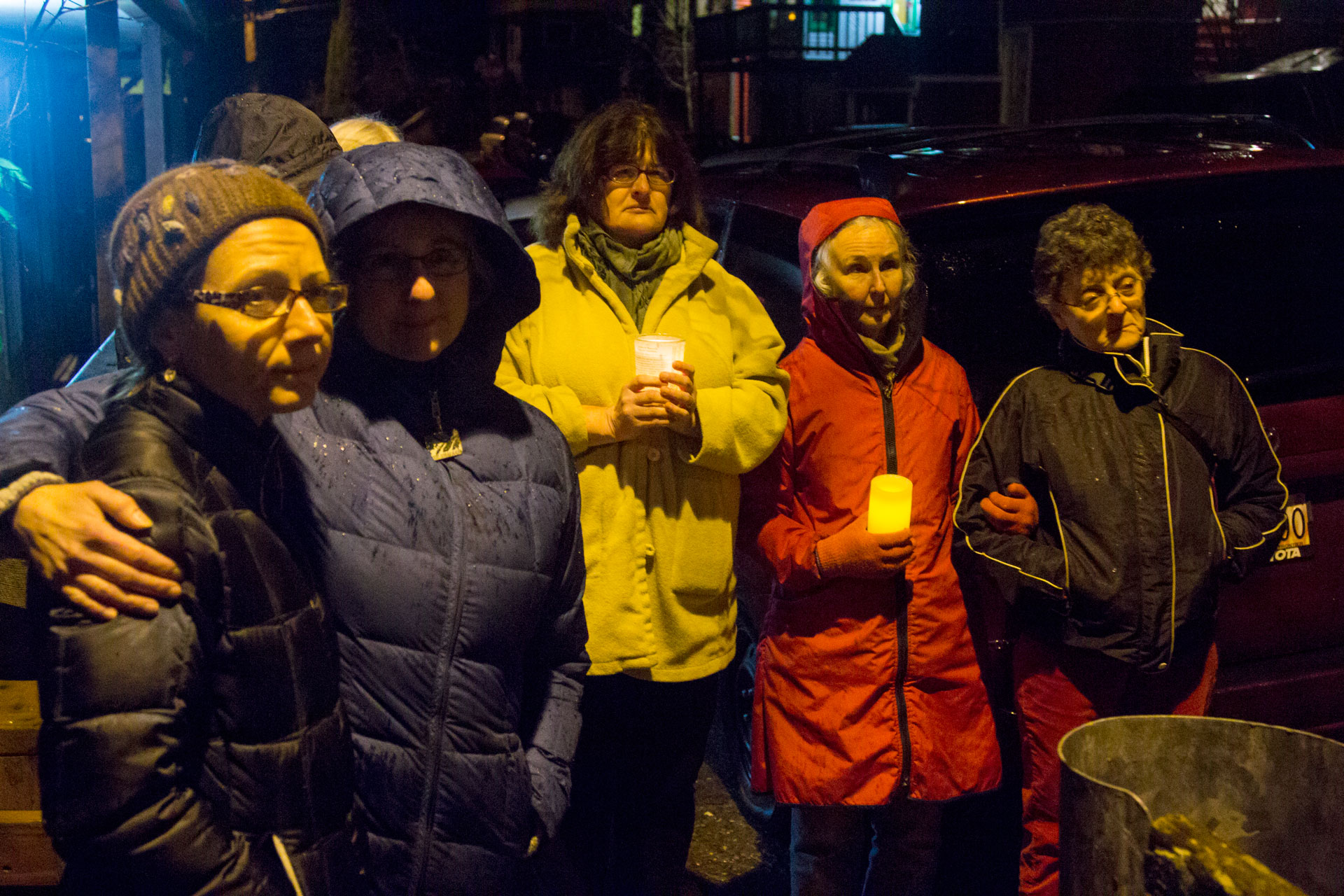 Neighbors gathered to remember Mayor Greg Fisk on Monday evening. They stood in silent respect, holding candles, as Fisk's body was removed from his home on Kennedy Street. (Photo by Mikko Wilson/KTOO)