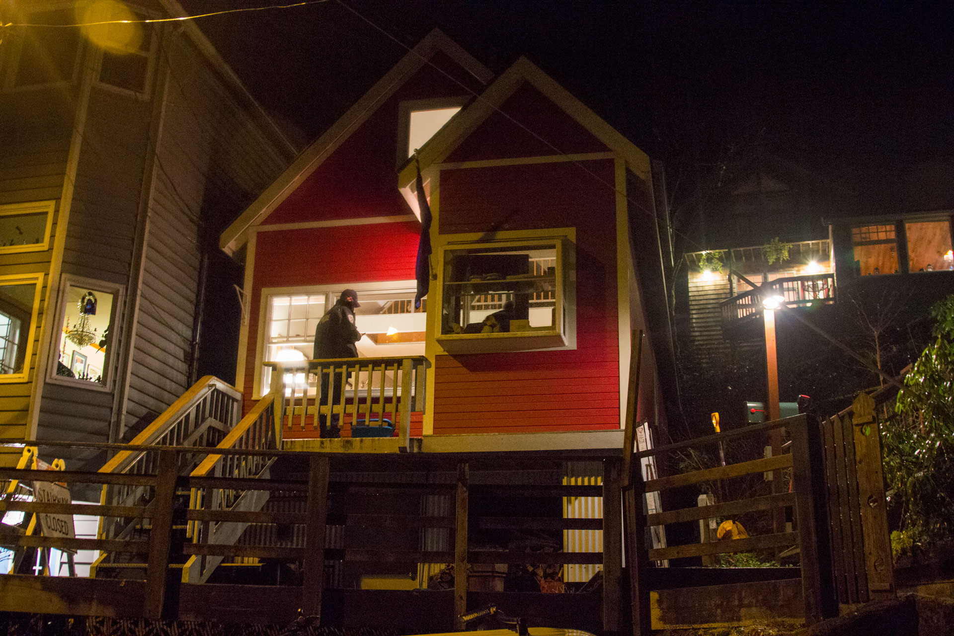 Juneau Police investigate the house of Juneau Mayor Greg Fisk on the evening of Monday November 30th. Photo by: Mikko Wilson / KTOO