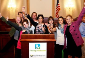 Alaskans were part of the UNITE to Face Addiction Rally in Washington, D.C.: Kim Whitaker, Julee Douglas, Samantha Garton, Terria Walters, Kara Nelson, Delia Williams, Jennifer Mcallister and Christina Love inside a congressional office building in D.C. in October. Nelson is holding a picture of Christopher Seaman, the son of Walters who was murdered in Mat-Su in June. (Photo courtesy Kara Nelson)