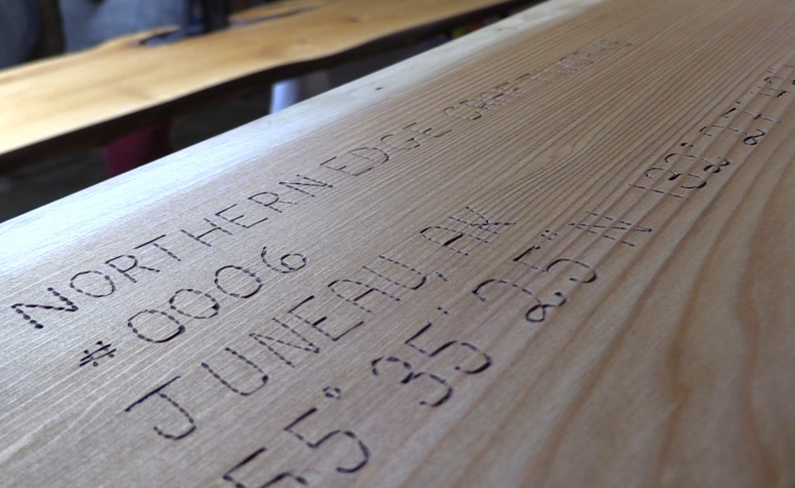 Furniture from Northern Edge Craftworks is marked with the GPS coordinates of the tree it came from. (Photo by David Purdy/KTOO)