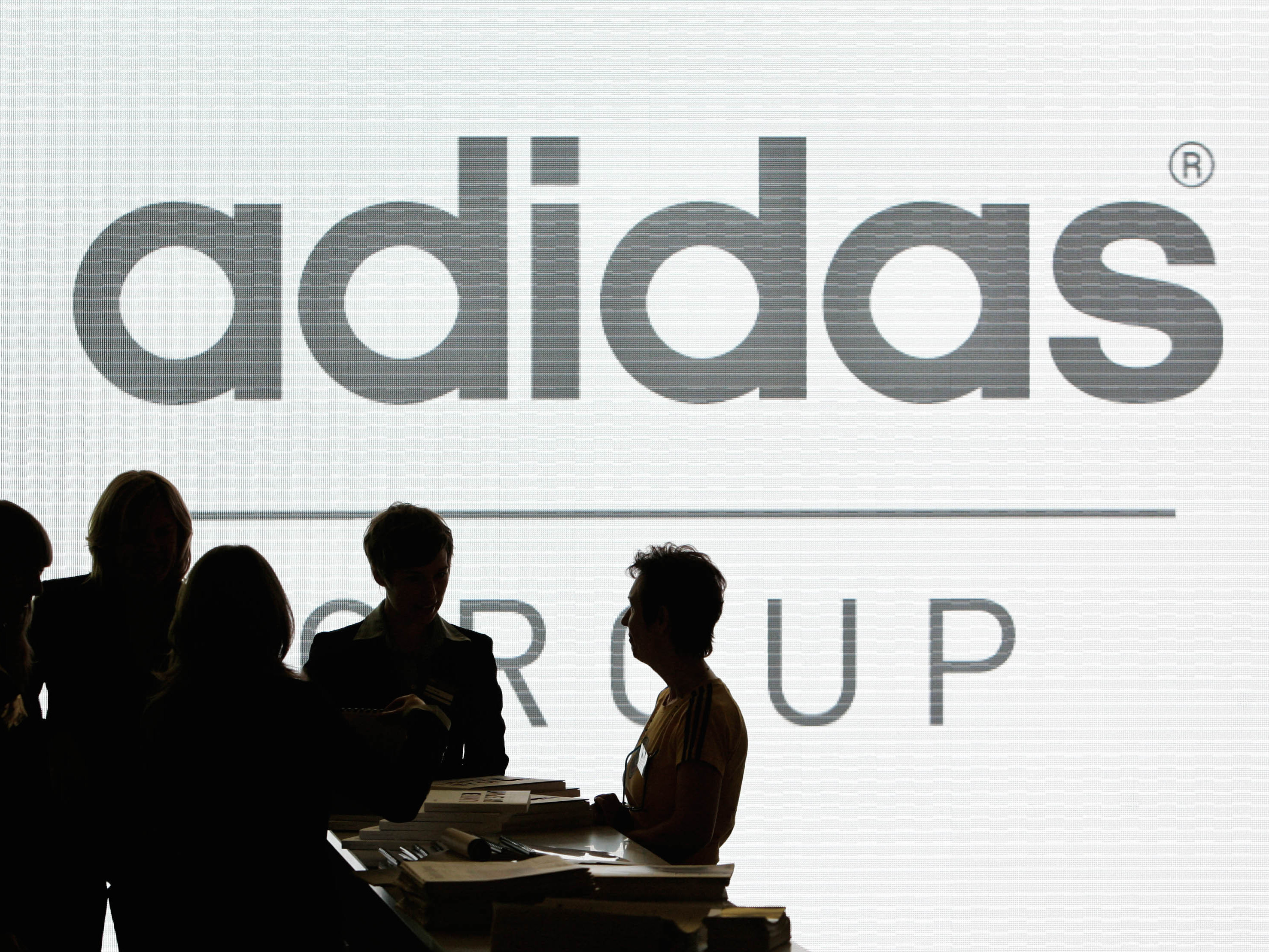 Adidas has pledged to help high school teams that want to change their mascots from Native American imagery. President Obama praised the effort, while the Washington football team shot back, calling the company's move hypocritical. Christof Stache/AP