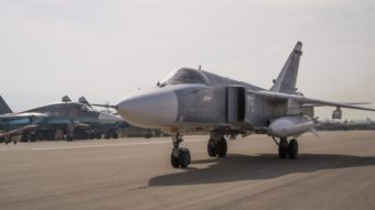 A Russian warplane taxies at Hemeimeem airbase in Syria. Advocates say a no-fly zone would keep Syrian aircraft from attacking anti-government rebels and endangering civilians, which might allow Syrians to feel safe enough to stay put. Vladimir Isachenkov/AP
