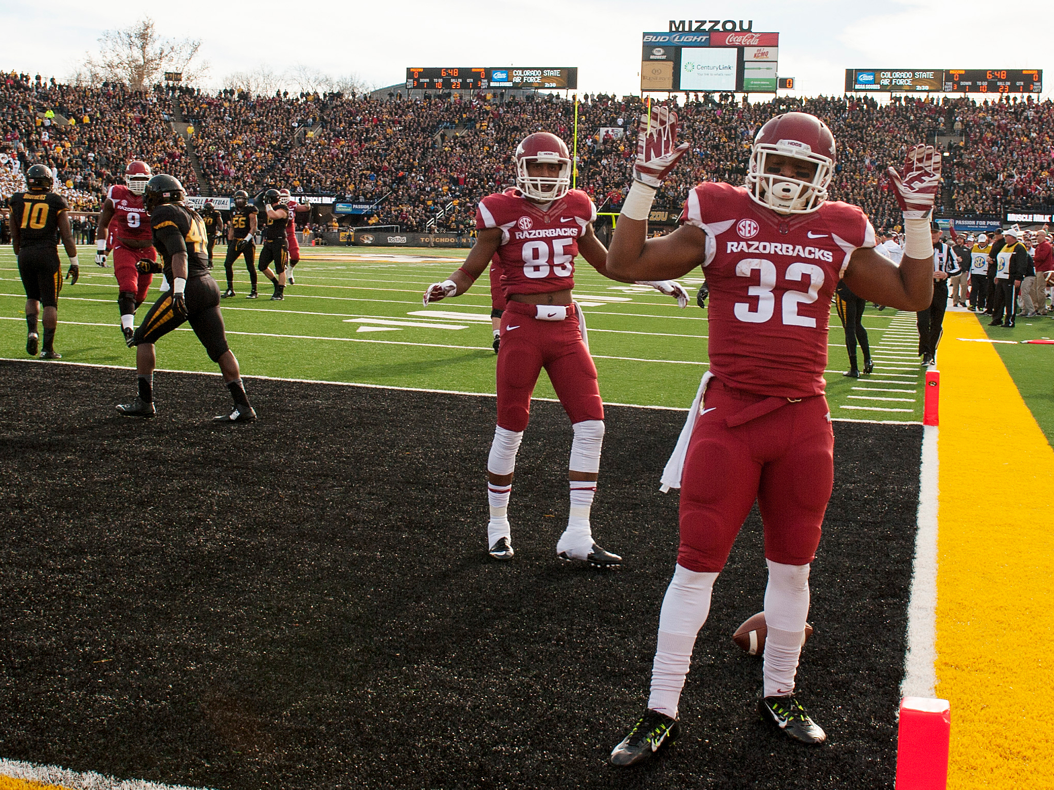 "Arkansas running back Jonathan Williams had just scored a touchdown against Missouri last season when he dropped the ball and raised his hands in a hands up, don't shoot"" gesture. L.G. Patterson/AP"