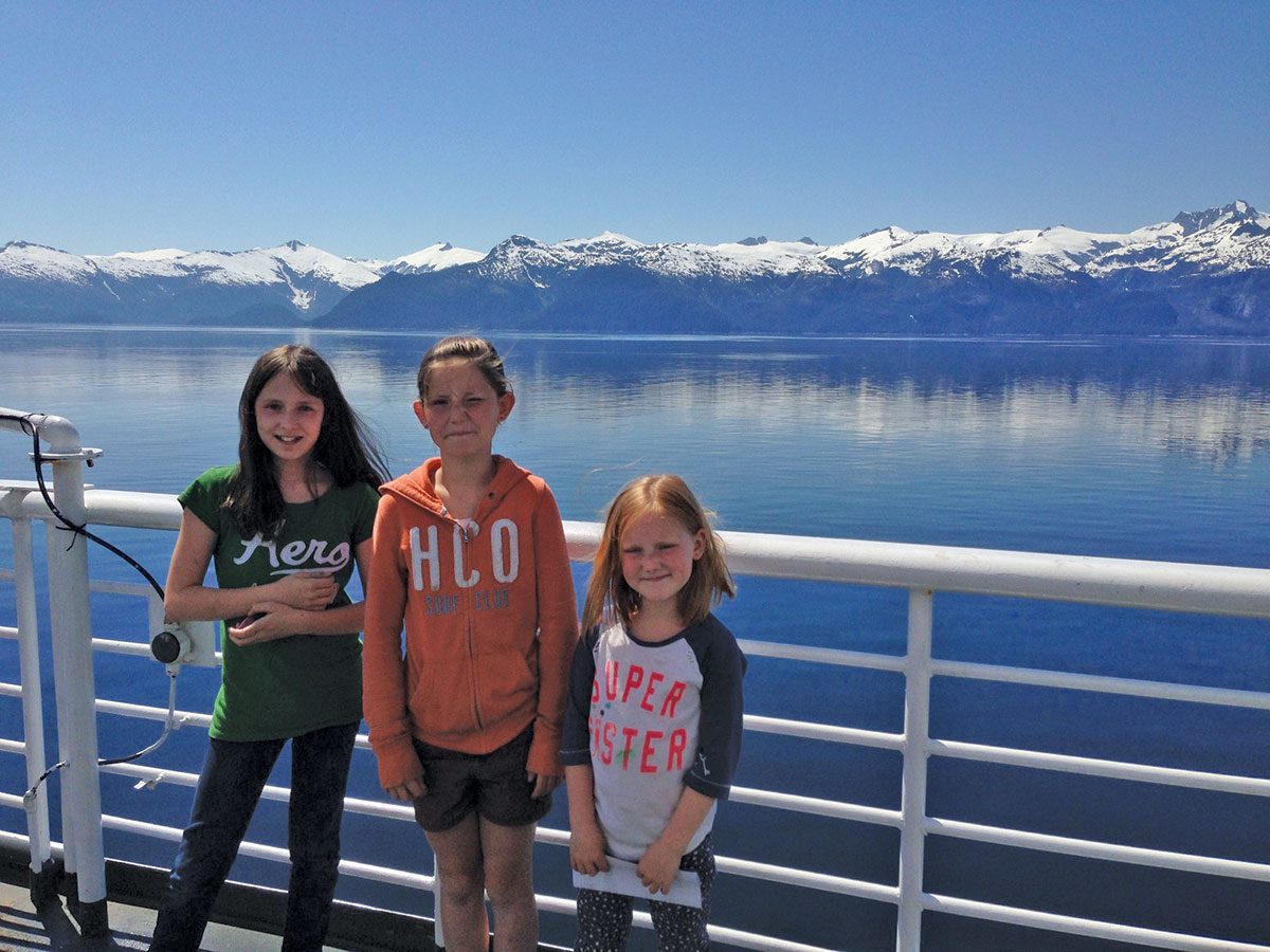 Children pose during an Alaska Marine Highway trip in Southeast Alaska. New rules for children traveling along remain on hold, officials say. (Photo courtesy AMHS)