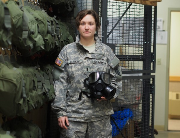 1st Lt. Elizabeth Eldridge holds an M40 Protective Mask inside the NBC Cage at JBER. (Photo by Zachariah Hughes/KSKA)