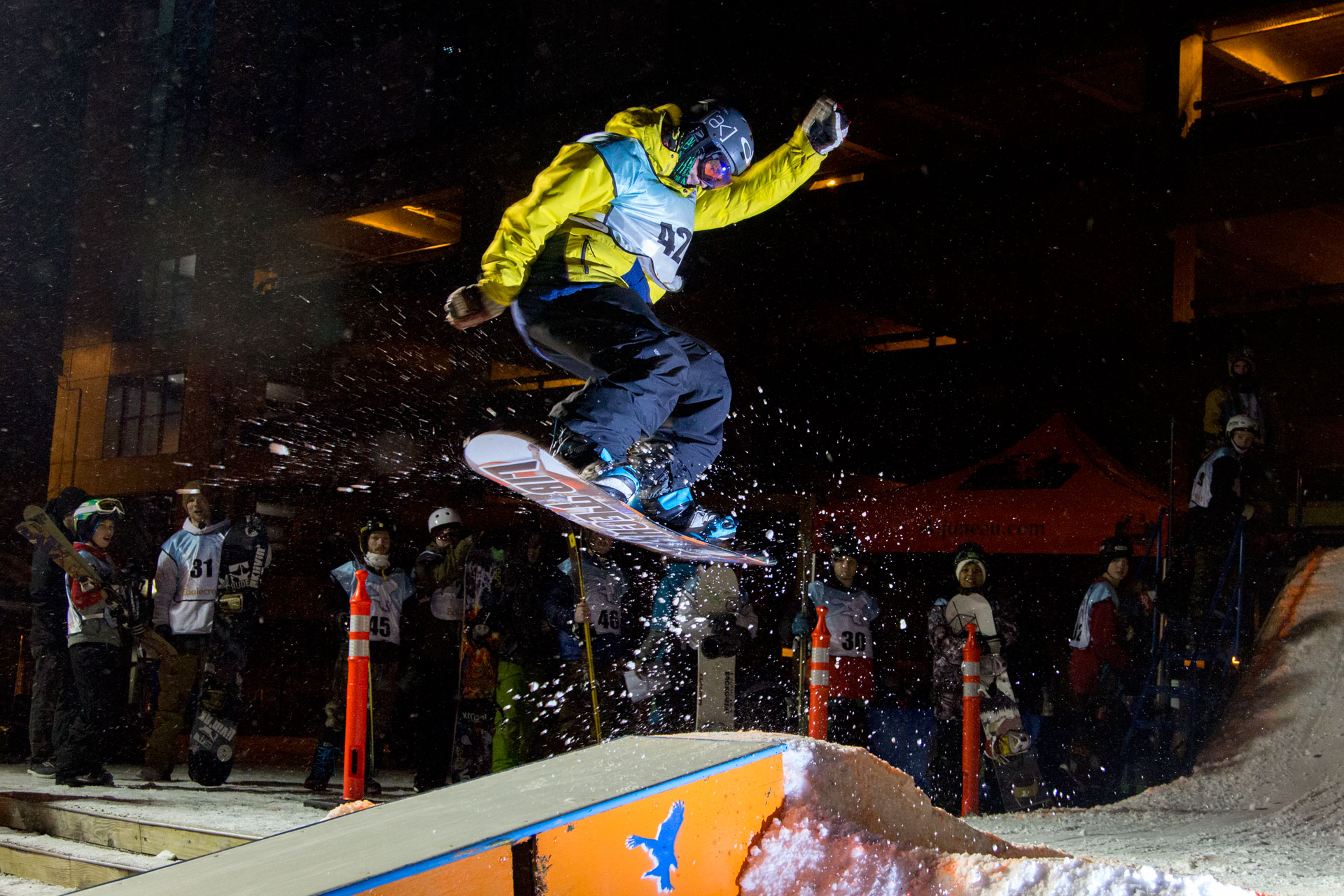 42 - Christian, soars over the box at the Downtown Rail Jam Dec. 19th. (Photo by Mikko Wilson/KTOO)