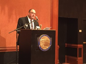 Commission Chair Greg Razo talks about the new report at the Captain Cook Hotel. (Photo by Anne Hillman/KSKA)
