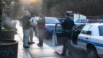 Juneau police investigate the scene of the alleged murder on Douglas Island Thursday morning. (Photo by Elizabeth Jenkins/KTOO)