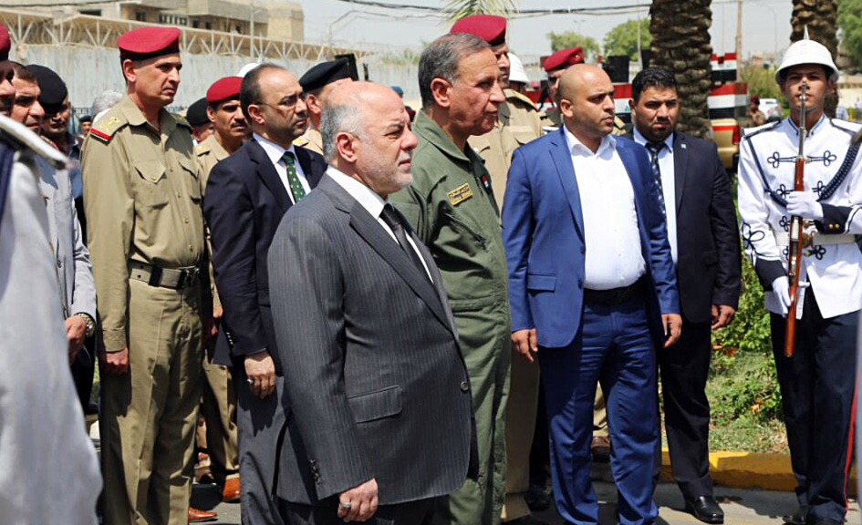 Iraqi Prime Minister Haider al-Abadi (center) attends a funeral for two generals killed in fighting with Islamic State militants in Ramadi, west of Baghdad, in August. In an interview Monday with NPR, the Iraqi leader called on the U.S. to provide more airstrikes but said his country does not want ground forces from the U.S. or any other country. AP