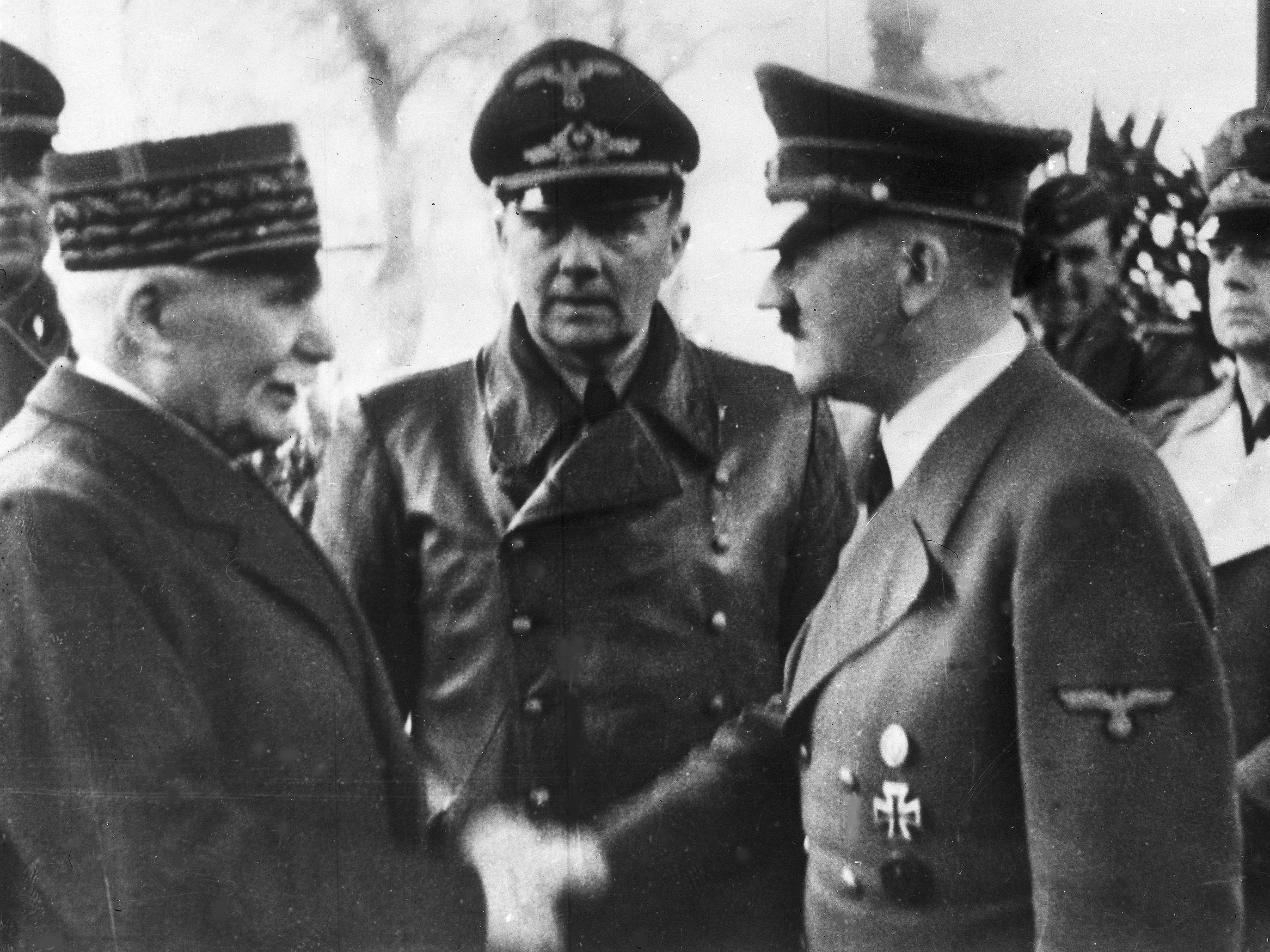 German Chancellor Adolf Hitler shakes hands with Head of State of Vichy France Marshall Philippe Pétain in occupied France on Oct. 24, 1940. AP