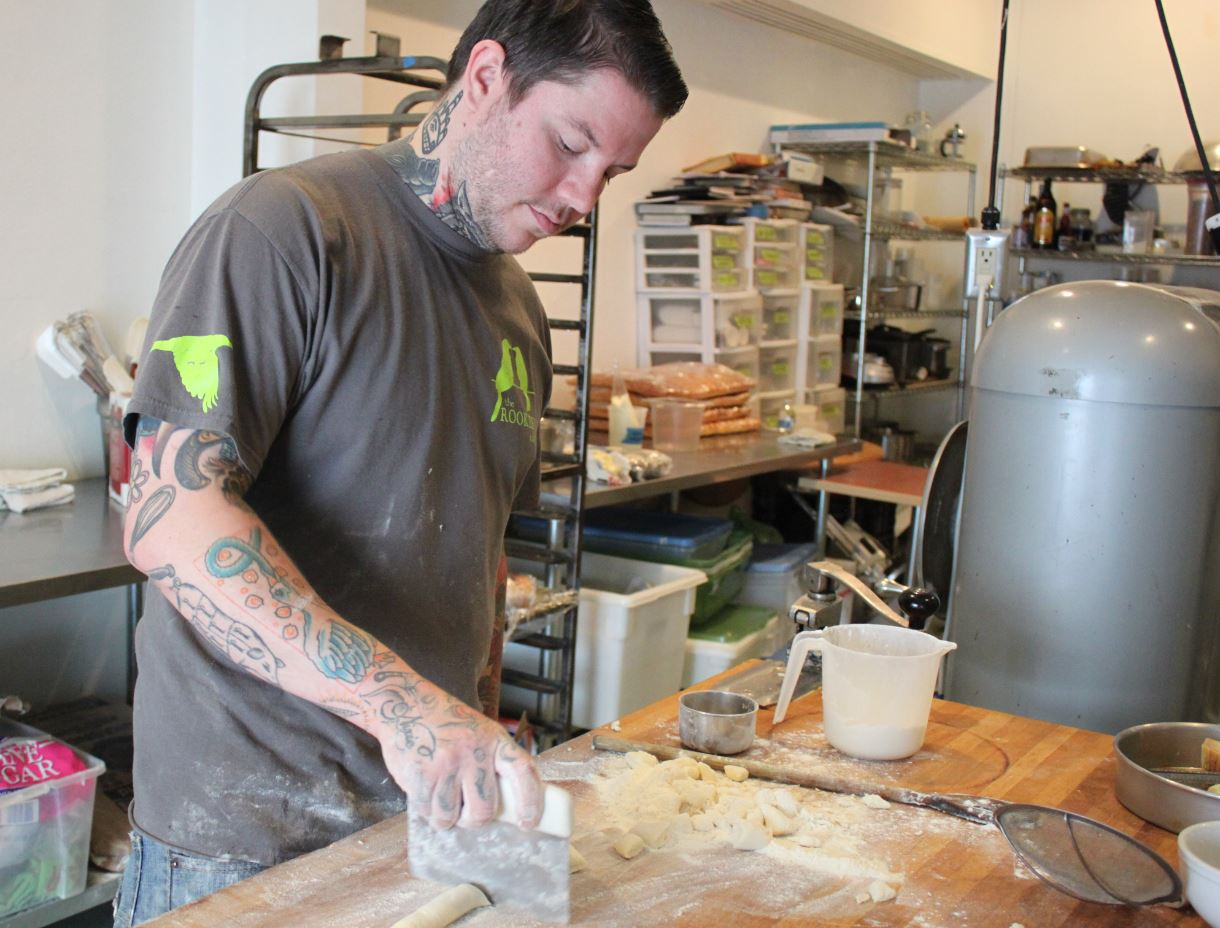 Beau Schooler makes ricotta gnocchi in the kitchen of Panhandle Provisions. (Photo by Lisa Phu/KTOO)