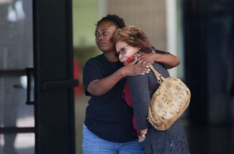 Two women embrace at a community center where family members have been gathering to pick up survivors after the shooting rampage at a social services center in San Bernardino, Calif. Jae C. Hong/AP