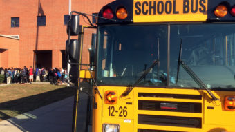 A school bus drop off students in Nashville, Tenn., where the city's school district has experienced one of the worst shortages of drivers in the country. Blake Farmer/WLPN