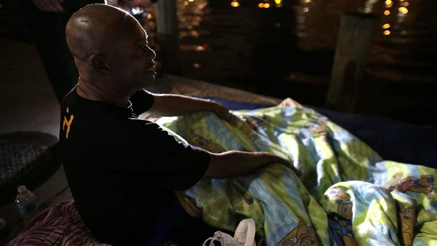 Homeless veteran James Thomas talks with officials in Miami. Miami-Dade County is one of hundreds of municipalities that had sought to end veteran homelessness by the end of this month. AP