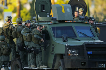 Police officers conduct a manhunt after a mass shooting in San Bernardino, Calif., on Dec. 2, 2015. Mike Blake/Reuters
