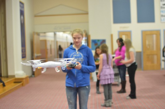 Hannah Moody pilots a drone at Point Higgins Elementary. (Photo by Ruth Eddy/KRBD)