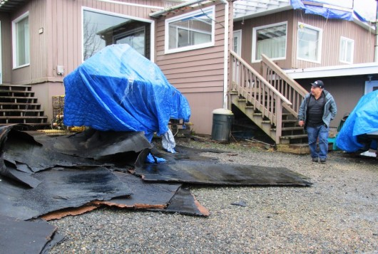 Roofing material is seen in the yard in front of Frank and Marge James' rented home off North Tongass Highway. The roof blew off in the storm earlier this week. (Photo by Leila Kheiry/KRBD)