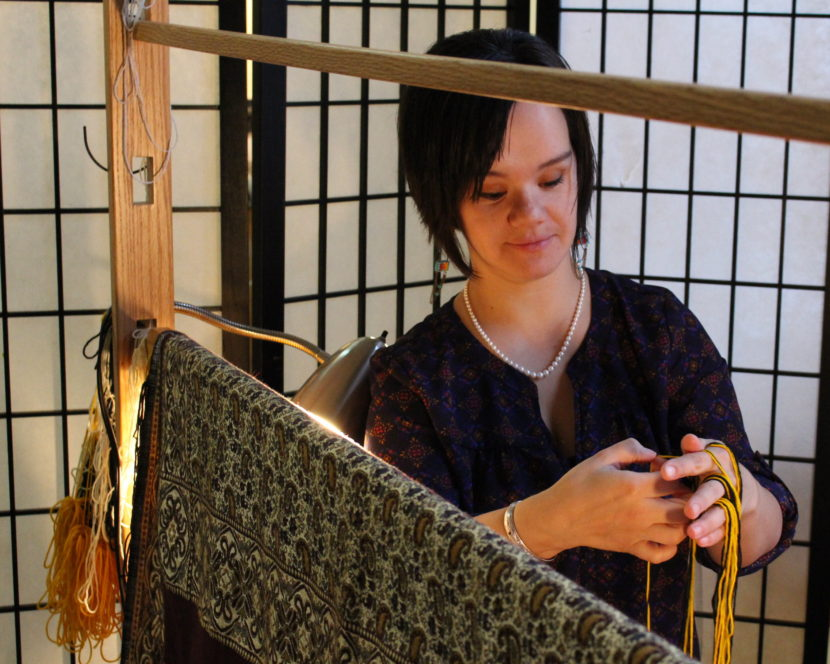 Keeping with tradition, Lily Hope covers her weaving. She won't publicly share photos until the blanket is finished. (Photo by Elizabeth Jenkins/KTOO)