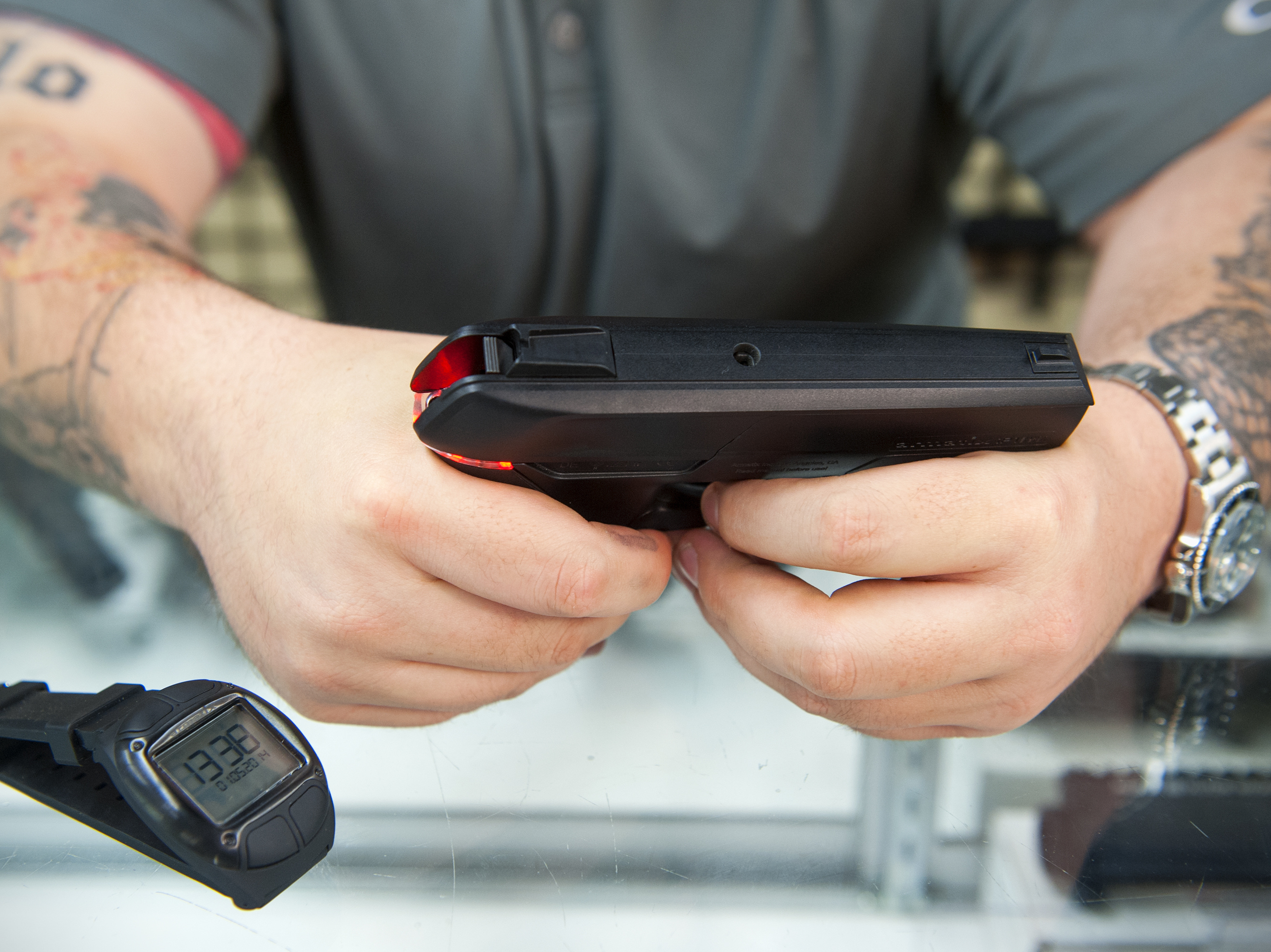 Andy Raymond demonstrates the Armatix iP1, a .22-caliber smart gun that has a safety interlock, at Engage Armaments in Rockville, Md., last year. Katherine Frey/The Washington Post/Getty Images