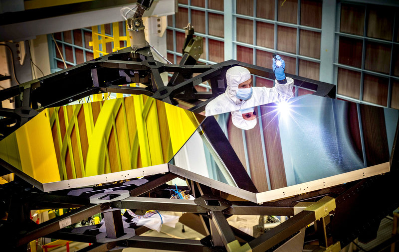 A NASA team has attached nearly all of the hexagonal segments that will together make the primary mirror for the James Webb Space Telescope (pictured are practice segments). Chris Gunn/NASA